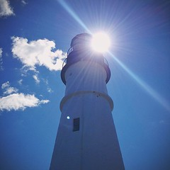 Lighthoused (mediafury) Tags: blue light sky sun lighthouse house me up look sunshine weather facade square portland lens outside harbor solar intense exterior looking maine down symmetry east squareformat len