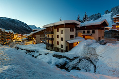 Illuminated Ski Resort of Madonna di Campiglio in the Morning, Italian Alps, Italy (ansharphoto) Tags: christmas street old city morning travel blue winter sky italy white house mountain holiday snow ski alps cold building tourism sport electric skyline architecture night river landscape lights hotel town high twilight europe italia european cityscape village dusk madonna peak landmark illuminated resort alpine di summit slope dolomites dolomiti campiglio