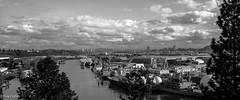 Portland, Oregon from the University of Portland (TomCollins) Tags: bridge clouds marina portland boats harbor blackwhite marine waterfront ships vessel maritime shipping portlandorgeon microfourthirds olympusomdem5 olympus17mmf18