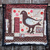 Brown Bird Folk Art Quilt (JoMo (peaceofpi)) Tags: bird folkart quilt buttons sewing quilting textileart fabric rawedge stitchedcollage artquilt peaceofpi canada animal outdoor wallart hanging frayed mixedmedia brown pink orange coral beads