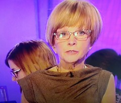 Anne Robinson on Watchdog upstaged by a hot girl with glasses in the background (GirlsWithGlassesGallery) Tags: bbc screencap watchdog researcher girlswithglasses bigglasses girlswearingglasses boldglasses girlswithglassesontv womenwearingglassesontv