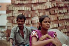 Uff ! (Sheikh Shahriar Ahmed) Tags: street brick film girl analog 50mm store candid streetlife fujifilm dhaka f18 maker bangladesh fatheranddaughter banasree candidportrait nikonf6 streetshop af50mmf18d fujicolorc200 peetha dhakadivision sheikhshahriarahmed
