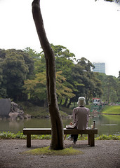 Bunkyō - Koishikawa Korakuen Garden (evangeline-san) Tags: park woman lake reflection green japan garden tokyo pond peaceful naturallight solitary lunchbreak koishikawakorakuen bunkyō urbansanctuary