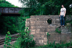 IMGP5559.jpg (highc0ntrast) Tags: railroad bridge portrait building abandoned overgrown wisconsin sandals depot greenery lodi