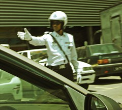 Mr. Traffic Man (PieceOfMindArt) Tags: people nikon candid sabah kk s3000