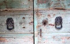 bagnoregio lions (1) (kexi) Tags: door 2 wallpaper two italy june canon couple italia lock pair lions knobs lazio bagnoregio instantfave 2013 dissymmetry