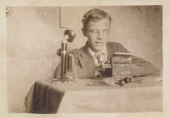 old white man black eye monochrome smiling vintage found glasses blackwhite phone antique telephone snapshot photograph vernacular eyeglasses foundphotograph