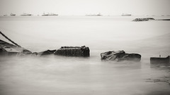 time slowed down - dreamscape (boxed_fish) Tags: longexposure sea blackandwhite bw white black water singapore rocks waves sony ships shore a7 tankers breakwater eastcoastpark sonya7 vision:text=0566 vision:outdoor=0923