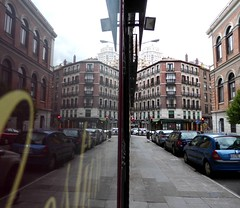 Cloudy day in Madrid (ashabot) Tags: madrid windows reflections windowshots spain europe cloudy streetshots cities streetscenes grayday