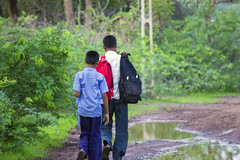 Children with his father to the school (NIRAV AJUDIA) Tags: school india green water beauty rain canon bag children geotagged puddle father monsoon 2015