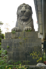 Britannia Bridge lion statue (schwerdf) Tags: anglesey bridges britanniabridge britishisles britishislestrip graffiti greatbritain regions statues wales