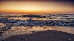 The promise... (Kerriemeister) Tags: sunrise dawn sand beach sandy sea waves glow pebbles morning nikon coast coastal