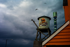 Wild West (Matthew Fleming Photography) Tags: park sea wild england sky orange storm west tower monument water lamp birds clouds coast seaside sand skies post mud side north stormy flats land theme sands morecambe polo frontier