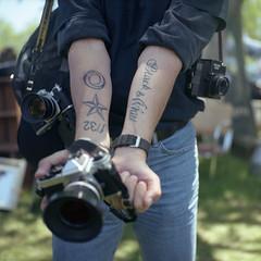 A Man, His Cameras and His Tats (BunnySafari) Tags: film tattoos professionalphotographer yashicamat fpp filmcameras kodakporta 100strangersproject christiesantiqueshow filmtattoos 100strangers61stephen