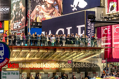 Crowd atop TKTS ticket booth admiring a big screen projecting an image of themselves. (Gerald Lau) Tags: nyc newyorkcity people newyork manhattan timessquare bigapple tkts duffysquare