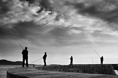 saturday morning howth (zip po) Tags: ireland sea blackandwhite howth monochrome clouds mono pier fishermen silhouettes