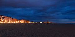 Oostende Beach at Dusk (Dennis Bevers) Tags: beach clouds evening blurry belgium dusk be coastline oostende bacheloretteparty flanders westflanders