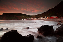 Pennan (angus clyne) Tags: sea summer cliff house sunrise dawn hotel bay coast scotland sand inn long exposure aberdeenshire harbour cottage scottish wave pebble wash swell vilage pennan
