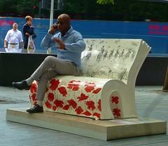 War Horse (helenoftheways) Tags: uk people freeassociation sitting sit poppies benches seated morelondon warhorse michaelmorpurgo booksabouttown gerardstrong
