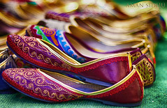 Punjabi women's ethnic footwear known as Punjabi Jutti (pronounced jeut-tii) I took this photo at Delhi Haat which is a an open air craft bazaar cum food plaza, a must visit if you are in Delhi. (Aman-Sidhu) Tags: feet shoes footwear womensshoes jutti leathershoes punjabijutti womensethnicfootwear