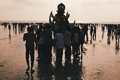 On the shoulders of men & into the sea (www.thestreetdogcollective.com) Tags: ocean india beach statue festival nikon idol mumbai ganpati d3s