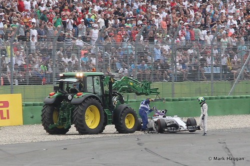 Felipe Massa gets out of his car after his first lap crash at the 2014 German Grand Prix