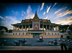A Storytelling Image of Cambodia  Royal Palace, Phnom Penh, Cambodia (Sam Antonio Photography) Tags: park travel blue roof sunset sky building art heritage tourism nature beautiful architecture clouds garden asian gold pagoda daylight hall scenery asia cambodia southeastasia downtown king khmer traditional famous capital sightseeing royal style sunny landmark palace motorbike exotic destination government pavilion phnompenh southeast residence luxury tranquil royalty mekong cultural royalpalace phnom pristine tonle phen kingdomofcambodia canon5dmarkii samantoniophotography canon1740f4lens