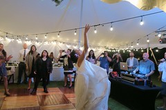 The Bouquet Toss (BarryFackler) Tags: amandajameswedding amandaalmeida jameshickey wedding marriage nuptuals event ceremony celebration specialoccasion reception dancefloor tent lights weddingguests bride weddingdress weddinggown bouquettoss bouquet dj diskjockey discjockey cellphones ladies gentlemen soundmixer tradition tables throw throwing toss tossing flowers floral hawaii polynesia hawaiiisland bigisland hawaiicounty westhawaii kailuakona hawaiianislands kona sandwichislands northkona 2017 painaplace ohiananiplace island february252017 barryfackler barronfackler tropical life