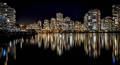 Bright Lights, Big City (Christie : Colour & Light Collection) Tags: falsecreek bc canada britishcolumbia reflections cityscape water nightlights nightphotography builidings night vancouver downtown stars nighttime star reflection light calm peaceful windows