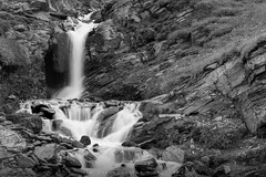 Falling Water (Tim Allendörfer) Tags: water waterfall white cold fresh falling stone rocks mountains grass blackandwhite alps alpen hochalpenstrase grosglockner nature landscape travel