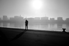 The sea fog is coming in (Hykkelbjerg) Tags: silhoutte man harbor morning industry fog mist backlit