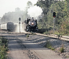 Southern Railway operated S&A 4-6-2, Alco built 1910, Light Pacific steam locomotive # 750, is seen departing the yard with a railfan excursion train, near block signal # 1542, at Valdosta, Georgia, November 1983, 2 of 6 (alcomike43) Tags: old color classic yard vintage ties switch photo pacific diesel smoke tracks engine slide trains historic steam southern photograph rails locomotive sa coal siding sr steamengine railroads ballast rightofway dieselengine southernrailway steamlocomotive turnout 750 alco mainline railroadyard emd passengertrains roadbed 462 diesellocomotive dieselelectriclocomotive valdostageorgia fp7a blocksignals lightpacific savannahatlanta coveredhoppers georgiasouthernfloridarailway passangercars weldedribbonrail railfanexcursiontrains cabcrewman