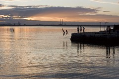 two by two! ~Explored#83 (Wendy:) Tags: sunset sea jumping harbour photowalk 50mmf14 dun laoghaire sandycove offshoot explored