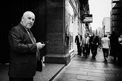 Men of Business (Ross Magrath) Tags: from street camera summer portrait bw white man black hot streets colour men face contrast digital wonderful dark walking lens four photography mono scotland weird high noir shadows gloomy serious glasgow no candid character north streetphotography sunny olympus panasonic business shade micro unknown shooting gloom hip agus f18 ban drama miserable et blanc sneaky compact thirds informal 17mm mft dubh gm1 rossmagrath