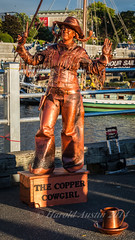 Copper Cowgirl (ausmc_1) Tags: canada statue waterfront britishcolumbia july victoria vancouverisland copper busker cowgirl innerharbour d800 2014 buskersfestival tamronsp2470mmf28divcusd