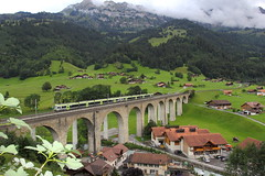 2 RABe 535 trains pass the famous bridge over the Kander river in Frutigen, Switserland (wrblokzijl) Tags: mountains alps nature train canon schweiz scenery swiss eisenbahn railway zug bern brug alpen bls 1740 trainspotting brig trein spoorwegen switserland zwitserland kander 1740f4l frutigen spoorlijn tellenburg nordrampe frütigen lötschberger rabe535 kanderbrücke lotschberger kanderbrück re3278