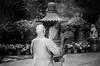 Buddhist monk lighting sticks near Po Lin Monastery, Hong Kong (Sander Pot) Tags: hongkong2016 hongkong asia monk priest buddha tian tan statue tiantanbuddhastatue bigbuddha blackandwhite bw sticks smoke lighting candles praying park temple postcard nikon d7000 monnik