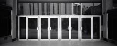 closed doors (pho-Tony) Tags: ricohr1 ilfordhp5plus prego micron rolleipregomicron ricoh r1 point shoot compact wide panoramic 24mm 30mm automatic film camera 35mm ishootfilm filmisnotdead expired ilford hp5 plus rodinal