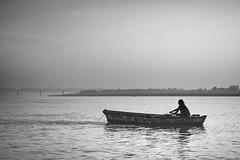 The Sun Rises on the Ganges - Varanasi, India (nicklaborde) Tags: 500px lumix lumixlounge gx7 black white watercraft boatman rowboat people water river canoe boat fishing adult monochrome ship oar fisherman vehicle transportation system recreation