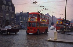 c1960 - Rainy day trolleys crossing the cobbles in North London. (RTW501) Tags: 1689 cgp689 k1leyland route679 manorhouse rain cobblestones wires overheads trolleywires