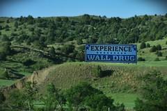 Billboard for Wall Drug in South Dakota (gravescout) Tags: wall southdakota souvenirs tourist billboard drugstore walldrug giftshop takenfromthecar takenfromcar