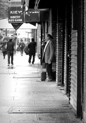 Singing in the Rain (Robert S. Photography) Tags: nyc people bw monochrome rain brooklyn streetperformers umbrellas canonpowershot rainydays 2014 a3400