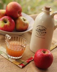 Apple Cider Vinegar (rosiemoonshine) Tags: food bottle dof bokeh naturallight vinegar apples applecidervinegar