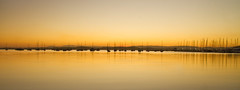 A panorama of Belmont Sunset (loobyloo55) Tags: sunset yellow reflections boats silhouettes