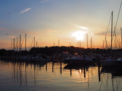 marina sunset after sailing (Zombie37) Tags: light sunset summer sky water lines marina reflections dark boats sailing maryland wiggly surface reflected late after straight masts ending