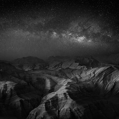 In the Light of Milkyway (Waheed Akhtar Photography) Tags: nightphotography light blackandwhite bw white black mountains art nature monochrome composite night canon dark square landscape mono photo moody shadows natural image famous fineart uae creative emirates infrared l rak starry f28 ef unitedarabemirates squarecrop bwphotography blackandwhitephotography rasalkhaimah milkyway 2014 arabemirates 1635mm ef1635 nightstars bwphotographer monoart 5dmarkiii waheedakhtar jabeljais