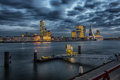 Rotterdam under clouds (zilverbat.) Tags: rotterdam clouds zilverbat hotspot harbor maasstad maas architecture bridge zwaan erasmusbrug water wallpaper world urban longexposurenetherlands city longexposurebynight lights winter wolken canon timelife town waterfront avondfotografie avond availablelight thenetherlands travel tourist tripadvisor tourism tour europe europa nightshot night nightphotography nightlights modern aanlegsteiger steiger