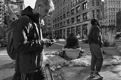 At 23rd and Broadway, Sunday Afternoon (sjnnyny) Tags: streetphoto newyorkers 23street broadwayat23 flatiron people pentaxk5iis pentaxhdda2040f2840limited stevenj sjnnyny nylife snow startofspring endofwinternyc urban downtown