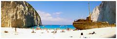 Navagio Beach (Eduard B. poze) Tags: sea beautiful water boat beach travel blue sun light clouds ocean outdoor summer man girl peaceful navagio zakynthos islands greece leica dlux 5