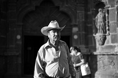 outside a church.. (camelot98.) Tags: leica city light shadow portrait urban blackandwhite bw man church monochrome hat contrast dark mexico religion streetphotography streetportrait sunny mexican sanmigueldeallende guanajuato summilux sma